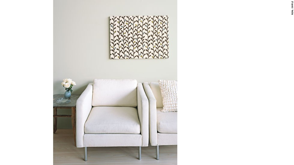 Easy DIY upgrade: Frame fabric for quick, inexpensive art. You'll need a staple gun, a stretched canvas (sold in art-supply stores), and some fabric, preferably heavy linen or cotton in a pattern without straight lines. Cut out a piece of the fabric that is four to six inches longer and wider than the frame. Place the material pattern-side down on your work surface, and center the canvas facedown on top of it. Then staple the cloth to the back of the frame