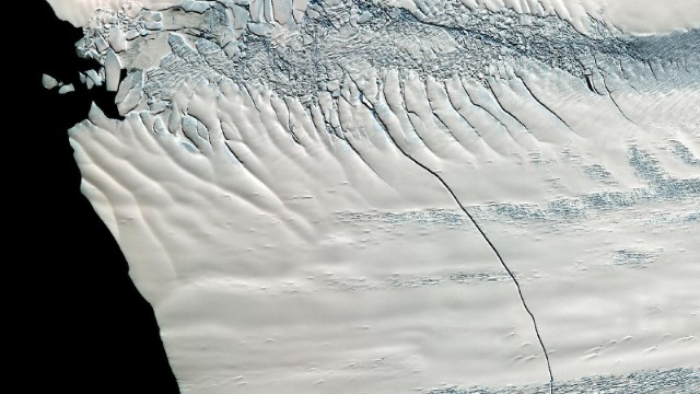 In mid-October 2011, NASA scientists working in Antarctica discovered a massive crack across the Pine Island Glacier.