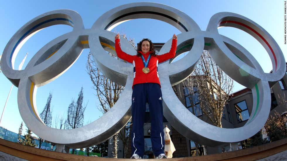 Williams poses with her gold medal in front of the Olympic rings. Four years earlier she had missed out on a spot at the Turin Games to compatriot Shelley Rudman, who won a silver medal in Italy.