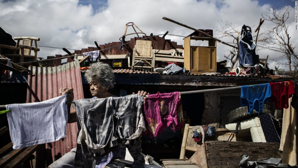 Teresa Mazeda hangs laundry in the ruins of her Tacloban home on Wednesday, November 13.