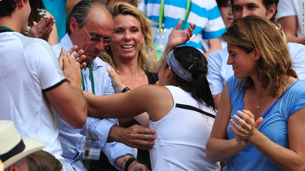 Bartoli made her way to her player box after the final and exchanged hugs with her team, which included dad Walter (middle) and former Wimbledon champion Amelie Mauresmo (right) who now coaches Andy Murray.
