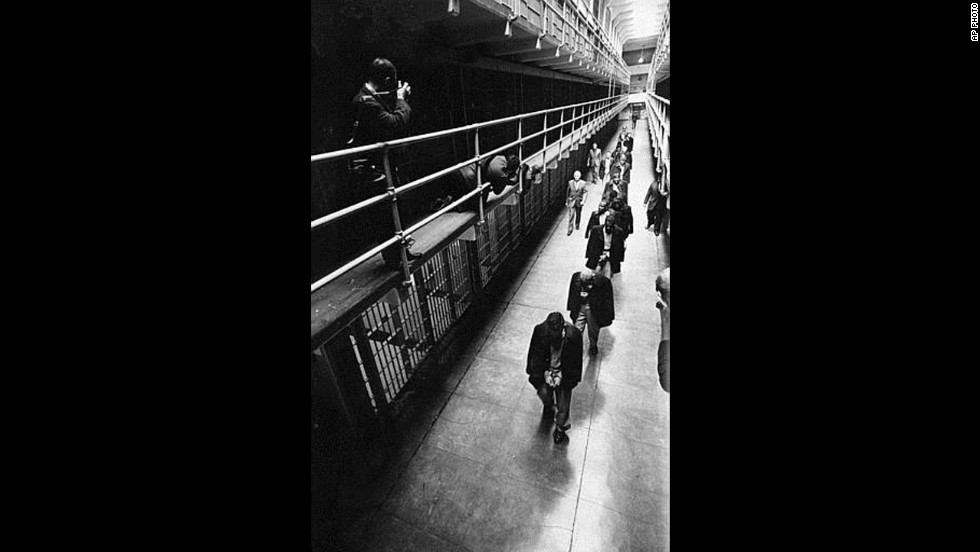 "A line of handcuffed prisoners, the last convicts held at Alcatraz prison, walk through a cell block as they are transferred to other prisons from Alcatraz Island on San Francisco Bay, California, on March 21, 1963. Alcatraz, known as ""The Rock,"" was a federal penitentiary for 29 years and a prison for more than a century."