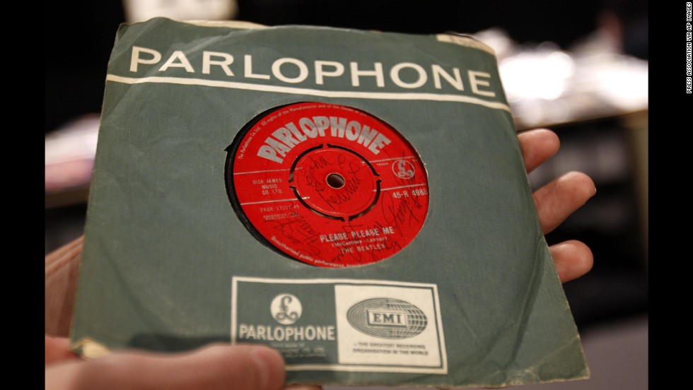 "The Beatles released their first album, ""Please Please Me,"" in the United Kingdom on March 22, 1963. A 7-inch copy of the single, seen here, was signed on both sides by the Fab Four and sold in 2011 for more than £9,000."