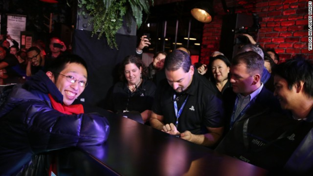 Joey Chiu, left, of Brooklyn, buys the first PlayStation 4 sold in North America at a launch event in New York City.
