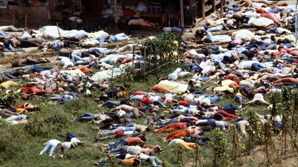 "Bodies lie around the compound of the People's Temple in Guyana on November 18, 1978, after the over 900 members of the cult died from drinking cyanide-laced Kool Aid, victims of the largest mass suicide in modern history. Jeff Guinn, author of ""Manson,"" said on CNN's ""The Seventies,"" ""we will never know how many people voluntarily drank the poison. But other people were either coerced, brainwashed, or took it against their will. They were murdered."""