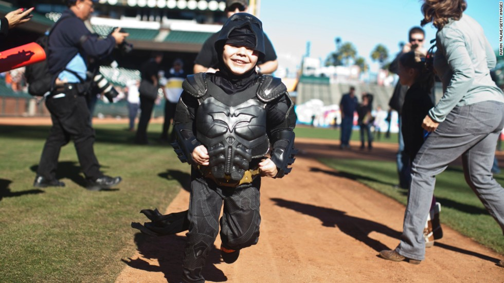 Miles, as Batkid, runs the bases at AT&T Park.
