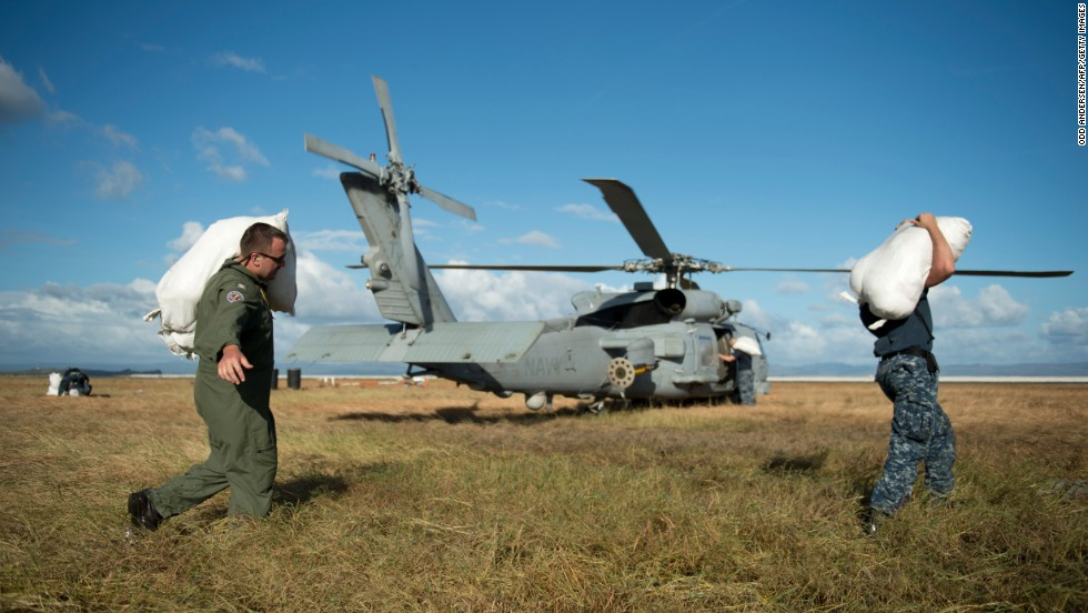 U.S. servicemen load emergency supplies onto a helicopter November 16 at the airport in Tacloban.