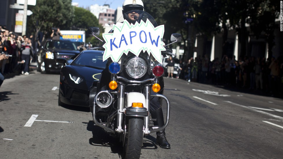 A San Francisco police officer on bike escorts Miles.