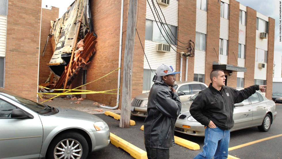 "An apartment manager warns Illinois State University students to stay back from a roof that blew off ""The U"" student apartments in Normal, Illinois, on November 17."