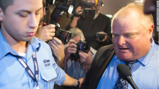 Toronto Mayor Rob Ford is surrounded by the media as he leaves his office at Toronto City Hall on November 15.