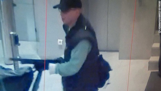 Footage from a security camera shows a man pointing a shotgun at employees of the BFM TV station in Paris, France.