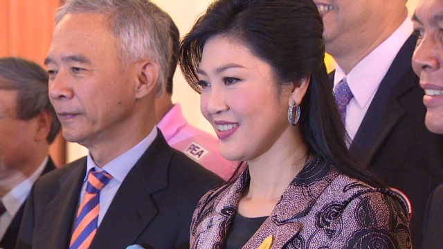 Thailand PM defies critics