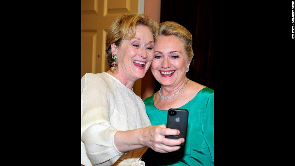 Actress Meryl Streep takes a photo of herself and Hillary Clinton after Clinton hosted a dinner for the Kennedy Center honorees in Washington.