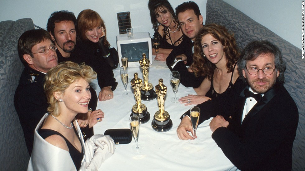 John, far left, sits at a table with other celebrities, including actress Kate Capshaw, singer Bruce Springsteen, actor Tom Hanks and director Steven Spielberg, at one of his foundation's parties in 1994. The party was held after the Academy Awards in Los Angeles.