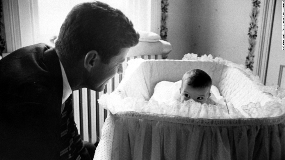 Sen. John F. Kennedy plays peekaboo with his 1-year-old daughter, Caroline, in 1958. He became President of the United States in 1961.