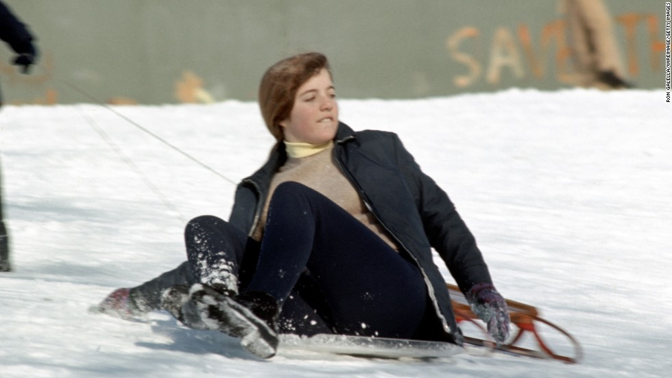Caroline, 13, sleds down a hill in New York's Central Park in 1971.