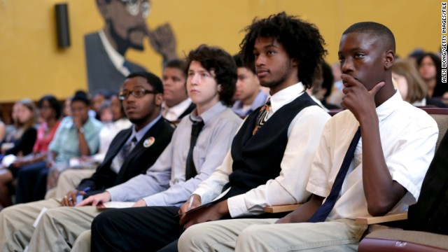 Students listen to Education Secretary Arne Duncan at an event in Washington in August.