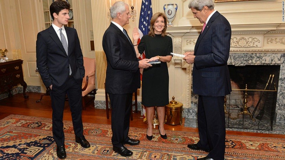 Kennedy is sworn in as U.S. ambassador to Japan by Secretary of State John Kerry, right, on November 12 in Washington. To her right is her husband and her son, John.