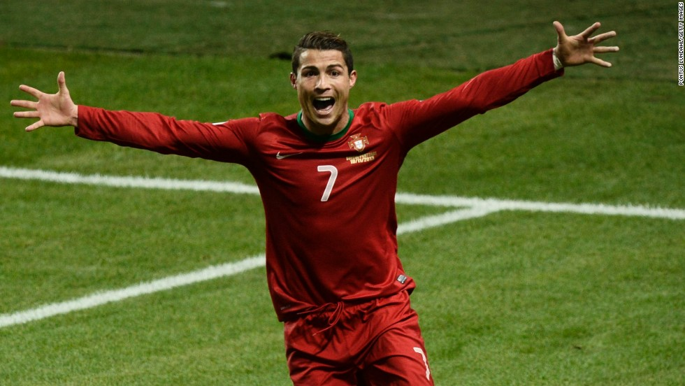 Cristiano Ronaldo celebrates the second of his three goals on a night when he not only sent Portugal to the World Cup but also became his country's joint top scorer (47 goals).