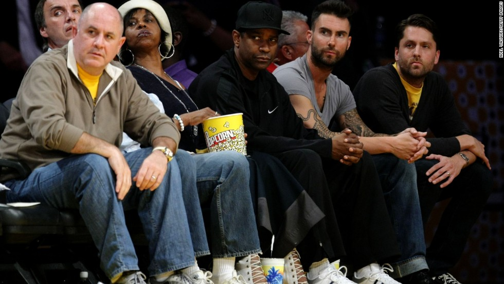 Levine, second from right, sits with Denzel Washington, center, at a 2009 NBA playoff game between the Los Angeles Lakers and the Denver Nuggets at the Staples Center in Los Angeles.