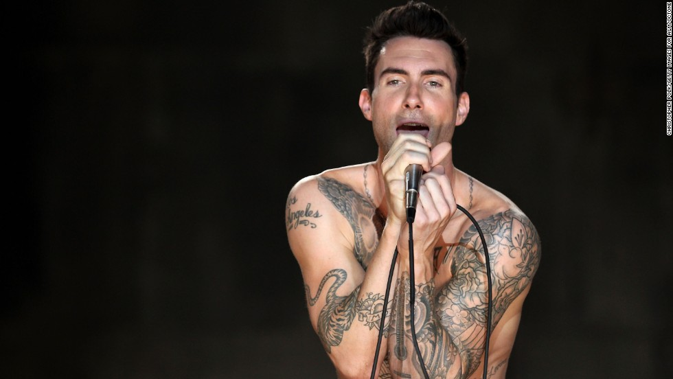 "Levine sings during the Maroon 5 video shoot for their song ""Moves Like Jagger"" in Los Angeles in 2011."