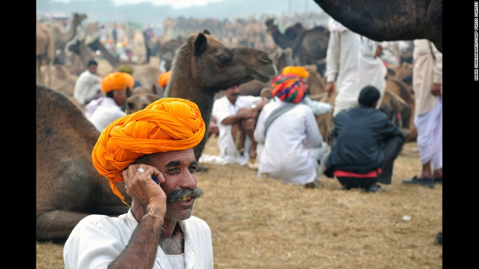 This Indian man received a loan that allowed him to buy and trade camels at the Pushkar Fair in Rajasthan, India.