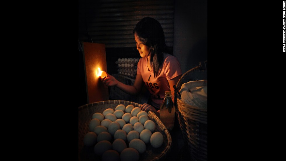 A vendor sorts duck eggs that have been fertilized or are developing duck embryos to be cooked. The eggs are then used in popular foods that are sold as street food.