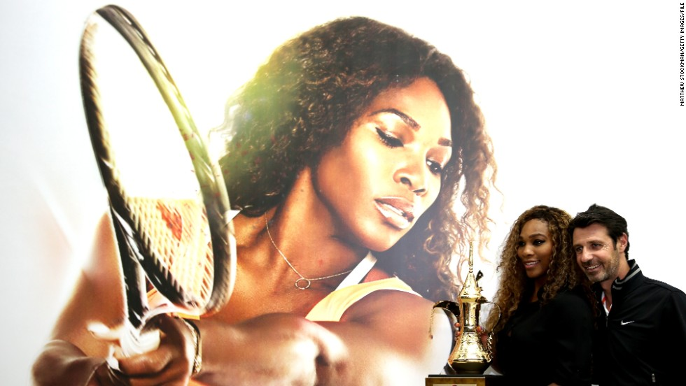 Serena Williams poses with her coach Patrick Mouratoglou after reclaiming the year-end world No. 1 ranking she last held in 2009.