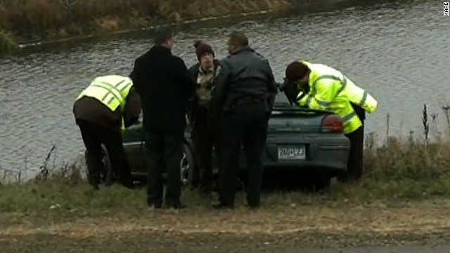 Police say rescue crews pulled a mother and five children from a holding pond after their vehicle slid off the highway and into the frigid water.