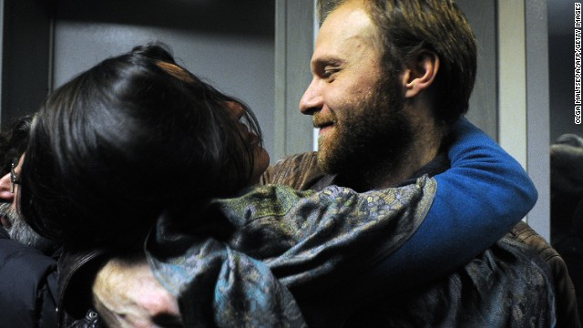 Photographer Denis Sinyakov, one of the 'Arctic 30,' hugs his wife Alina as he is released on bail on November 21 in Russia.