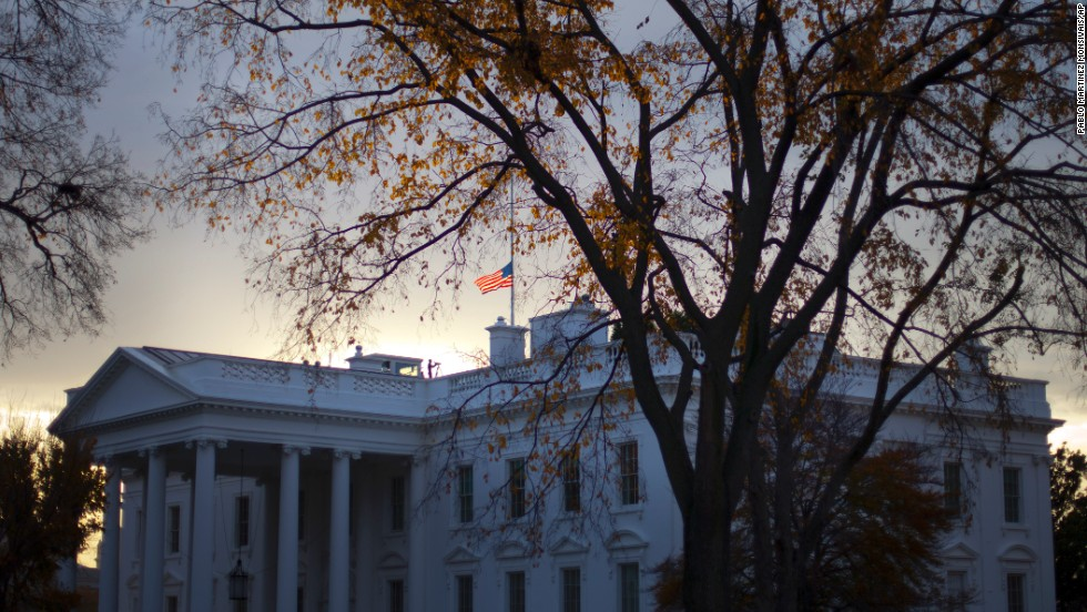 "A flag flies at half-staff above the White House on November 22. President Barack Obama said the anniversary is a day to honor Kennedy's memory and ""celebrate his enduring imprint on American history."""