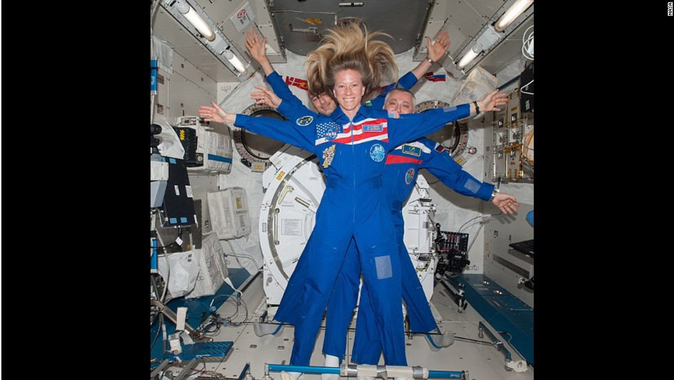 NASA astronaut Karen Nyberg takes a selfie with Russian cosmonaut Fyodor Yurchikhin and European Space Agency astronaut Luca Parmitano behind her.