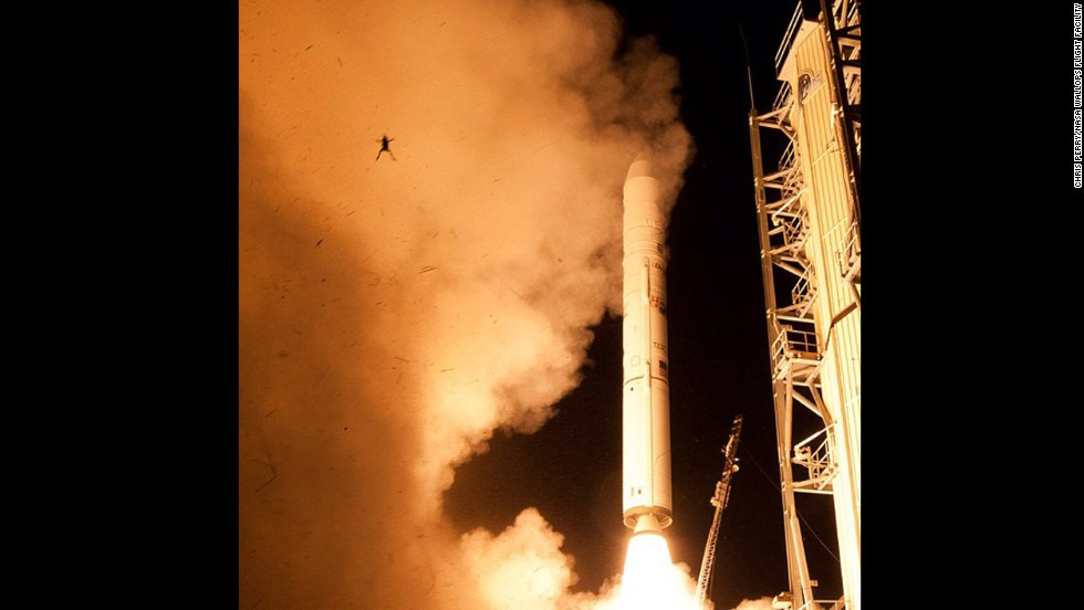 "There it goes! A still camera on a sound trigger captured this intriguing photo of an airborne frog in the foreground as NASA's  Lunar Atmosphere and Dust Environment Explorer spacecraft lifts off toward the moon. This <a href=""http://www.cnn.com/2013/09/12/tech/innovation/frog-and-rocket/"">foreground photobomber stole the show</a>, earning this snap almost 25,000 likes."