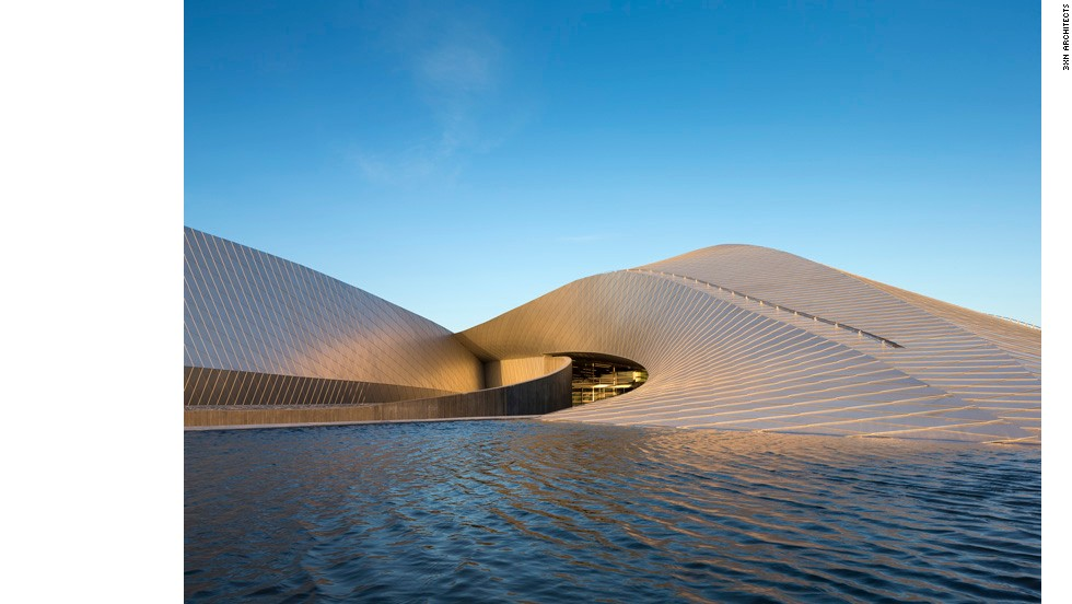 The Blue Planet in Copenhagen, northern Europe's largest aquarium, opened to the public in March. Located on the waterfront, its gently sloping wings resemble a whirlpool that binds the sea and land together.