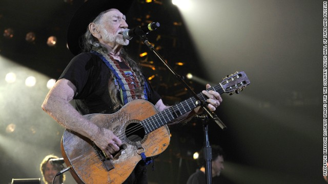 NASHVILLE, TN - APRIL 16:  Willie Nelson performs during Keith Urban's Fourth annual We're All For The Hall benefit concert at Bridgestone Arena on April 16, 2013 in Nashville, Tennessee.  (Photo by Frederick Breedon IV/Getty Images for the Country Music Hall of Fame and Museum)