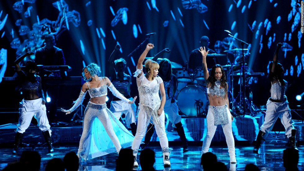 "From right, Chilli and T-Boz of TLC perform their song ""Waterfalls"" with Lil Mama filling in for the late Lisa ""Left Eye"" Lopes."