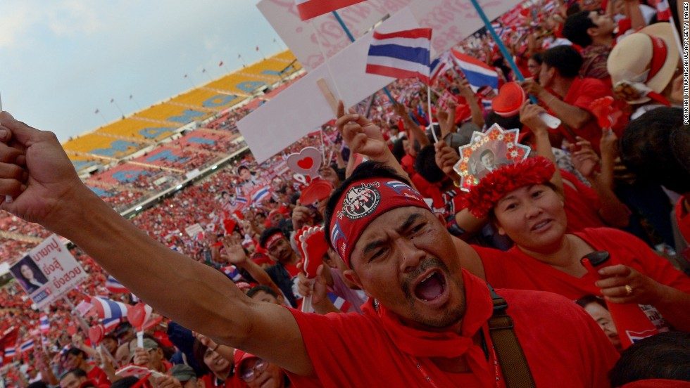 Thai pro-government 'red shirts' gathered at a football stadium to counter the growing anti-government protests and to show support for Prime Minister Yingluck Shinawatra's crisis-hit administration.