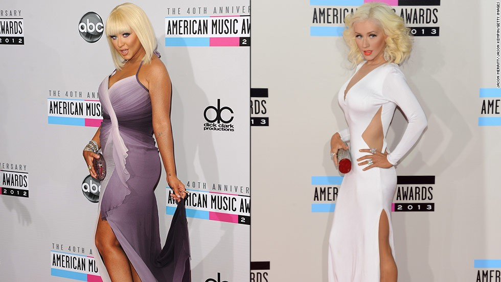 Christina Aguilera turned heads on the American Music Awards' red carpet for two years in a row. At the awards ceremony in 2013, Aguilera surprised onlookers by arriving in a skin-tight white gown with revealing cutouts, displaying a much different look than her voluptuous appearance at the 2012 event.