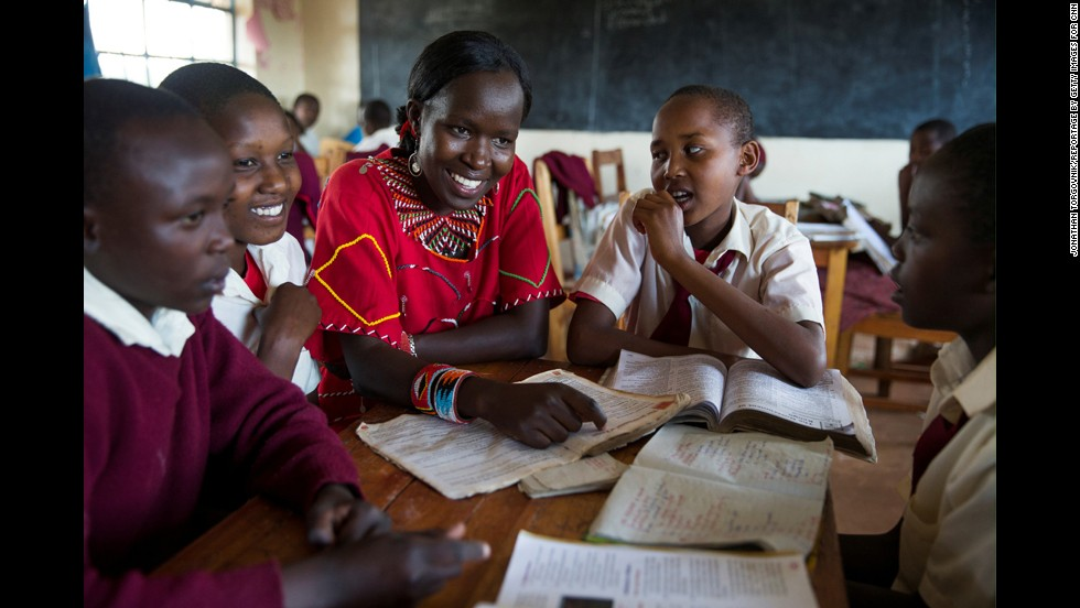 "Ntaiya helps students with their studies at the <a href=""http://www.kakenyasdream.org/"" target=""_blank"">Kakenya Center for Excellence</a> in Enoosaen, Kenya. Despite free primary education being mandated 10 years ago by the Kenyan government, educating girls is still not a priority for Ntaiya's Maasai culture. According to the Kenyan government, only 11% of Maasai girls in Kenya finish primary school."