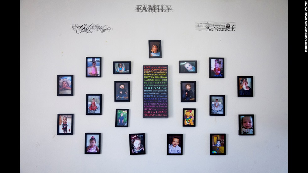 Photos are seen on the wall of the children's home in Cape Coral.