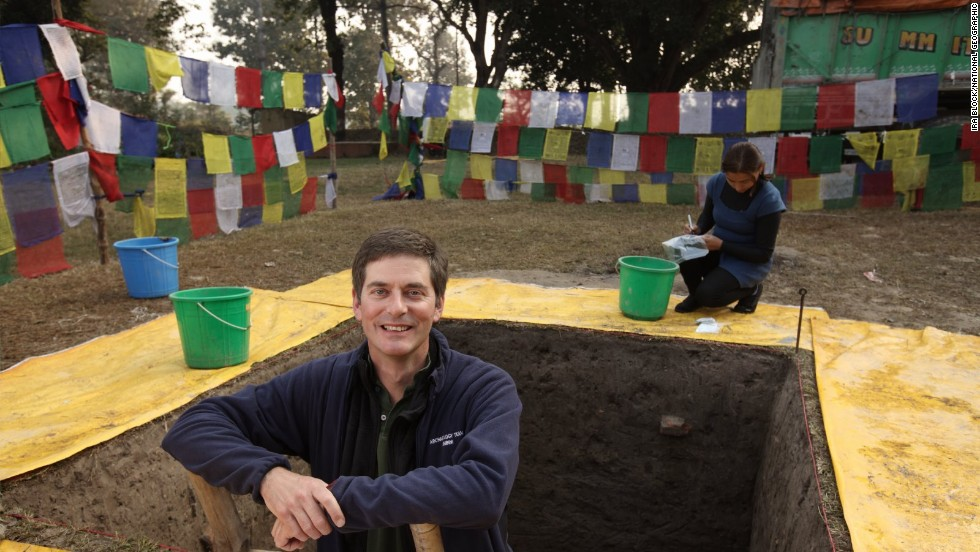 Archaeologist Robin Coningham of Durham University in the United Kingdom emerges from the dig at the Lumbini Village Mound in Nepal. He led a study describing the oldest Buddhist shrine ever found.