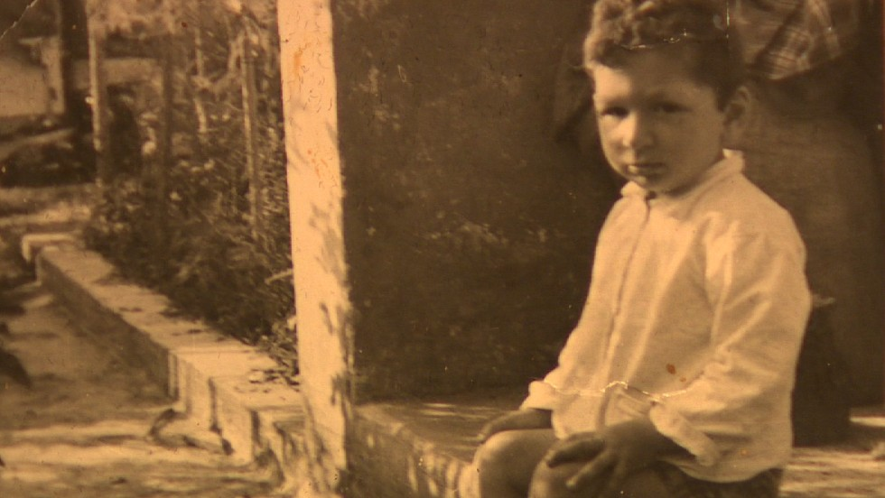Riva pictured as a boy, before neurofibrosis began to take hold.