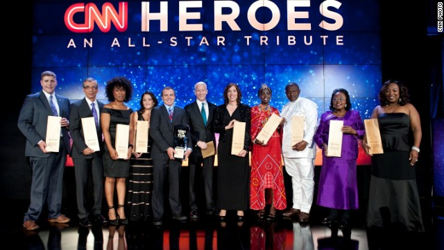 The Top 10 CNN Heroes of 2013 join Anderson Cooper on stage at last year's Tribute Show in New York.