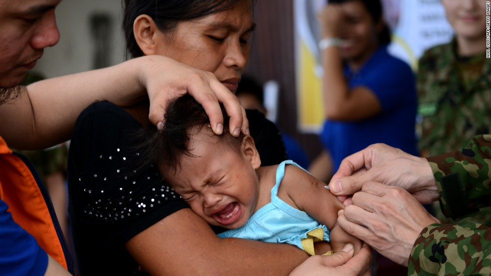 "A baby receives a measles vaccine in Tacloban, Leyte province, on Wednesday, November 27. Haiyan, one of the strongest storms in history, has affected 4.3 million people in the Philippines, and many of them rely on emergency relief for food and water. <a href=""http://www.cnn.com/SPECIALS/impact.your.world/"">See how you can help.</a>"