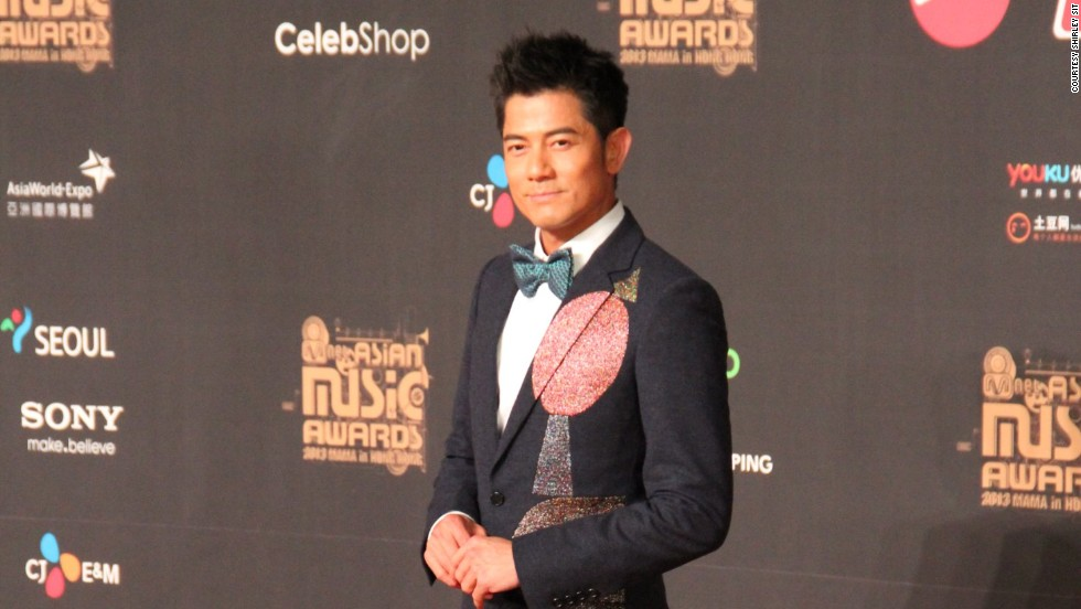 "Hong Kong superstar Aaron Kwok arrives at the red carpet at MAMA. The singer, actor and dancer won an award for ""Best Asian Artist"" and performed a duet with Stevie Wonder and Sistar's Hyolyn."