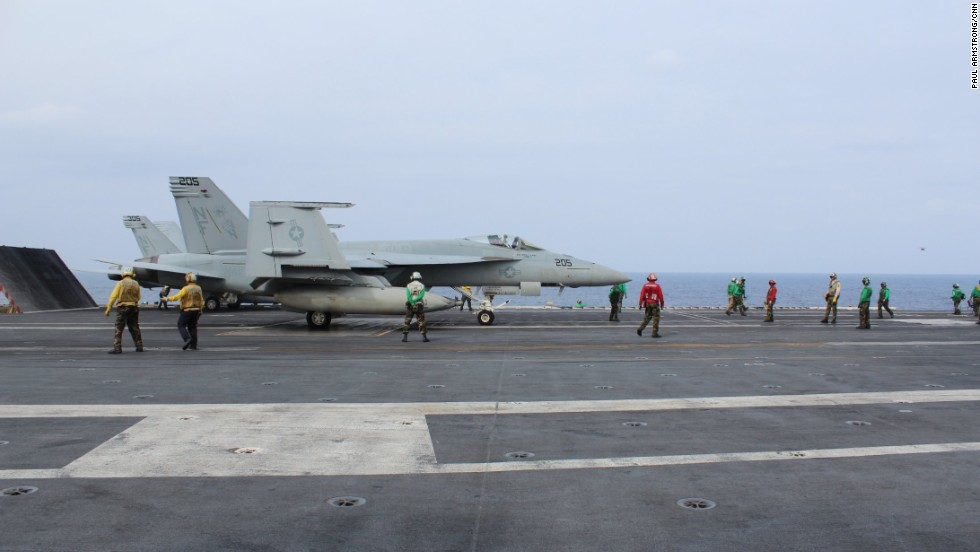 Crew working on the flight deck wear different colored vests according to the duties they peform, from refueling to maintenance.