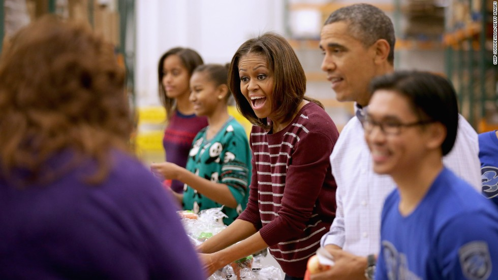 Michelle Obama attends a service event with her husband and daughters, Sasha and Malia. Obama is the face of the Let's Move! campaign tackling childhood obesity in the United States.