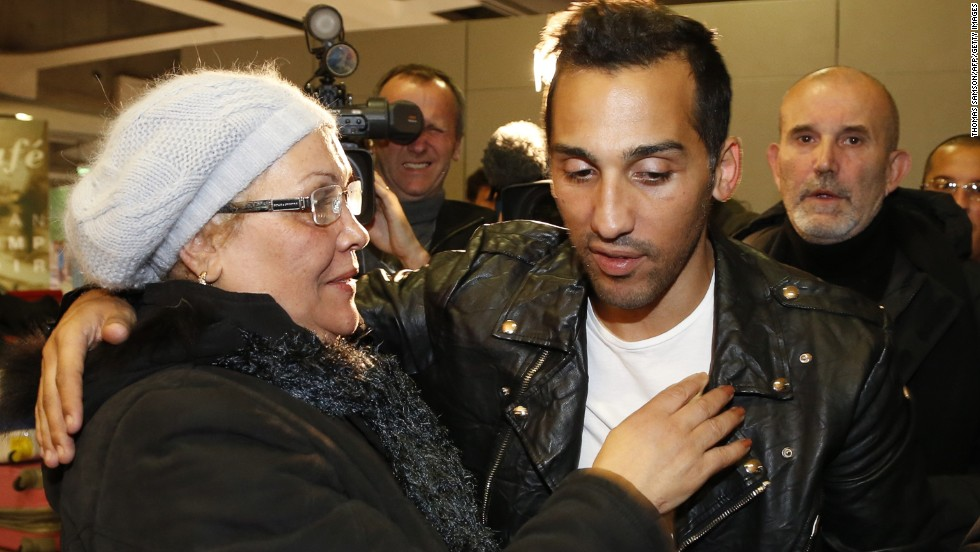 Football player Zahir Belounis (right) is welcomed by his mother as he arrives from Qatar at Paris' Roissy-Charles-de-Gaulle airport on November 28, 2013.