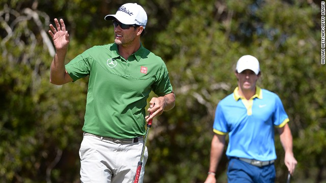 Adam Scott (left) put a little bit of distance between himself and nearest rival Rory McIlroy at the Australian Open on Saturday.