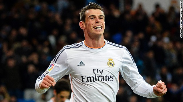 A beaming Gareth Bale celebrates after completing his hat-trick against Real Valladolid on Saturday.